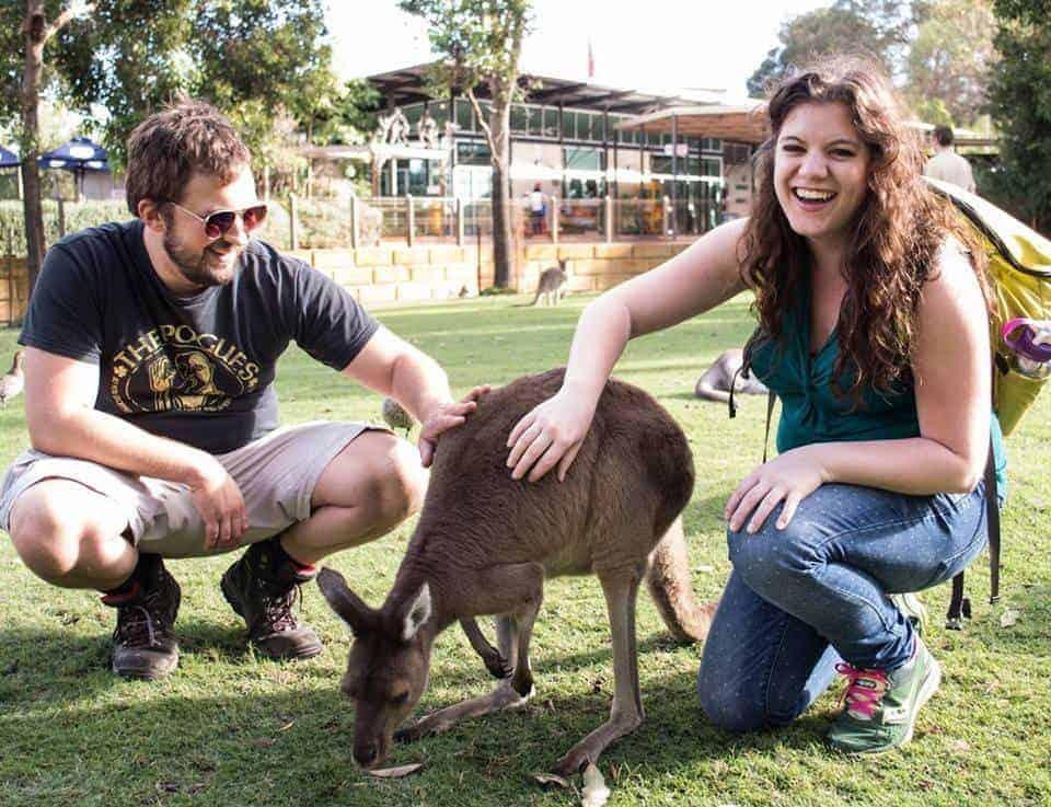 cute things couples do - two drifters petting a kangaroo