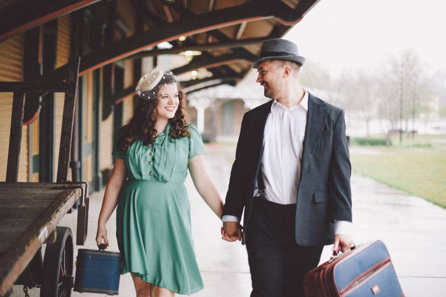 traveling with your partner - man and woman in vintage clothing