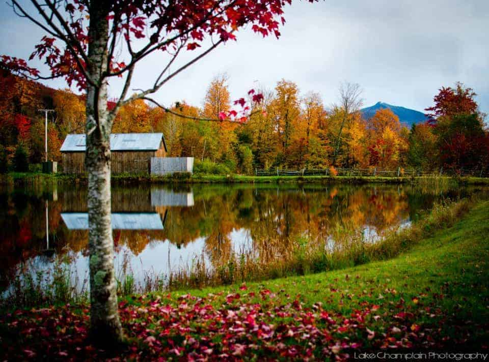 fall in new england - lake with reflection in Vermont