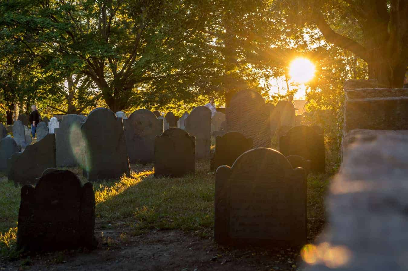 October in Salem Ma - evening light shines onto old gravestones under low trees
