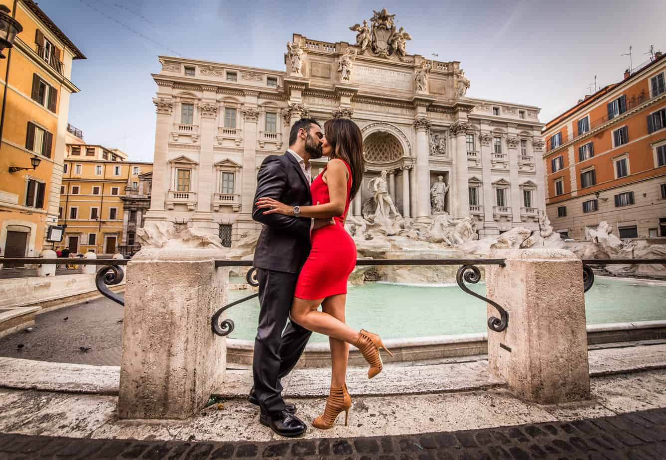 most romantic places in europe - couple kissing in front on rome's trevi fountain