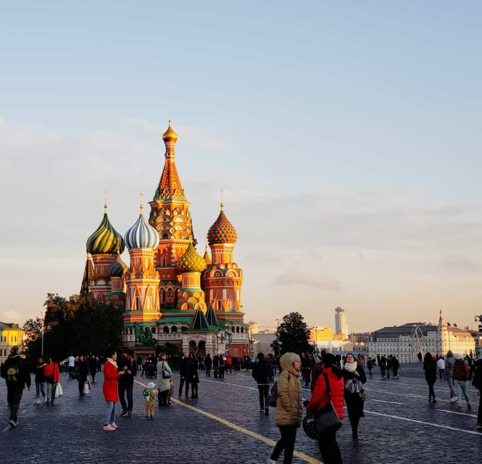 things to do in moscow - st. basil's cathedral at sunset, crowds around it