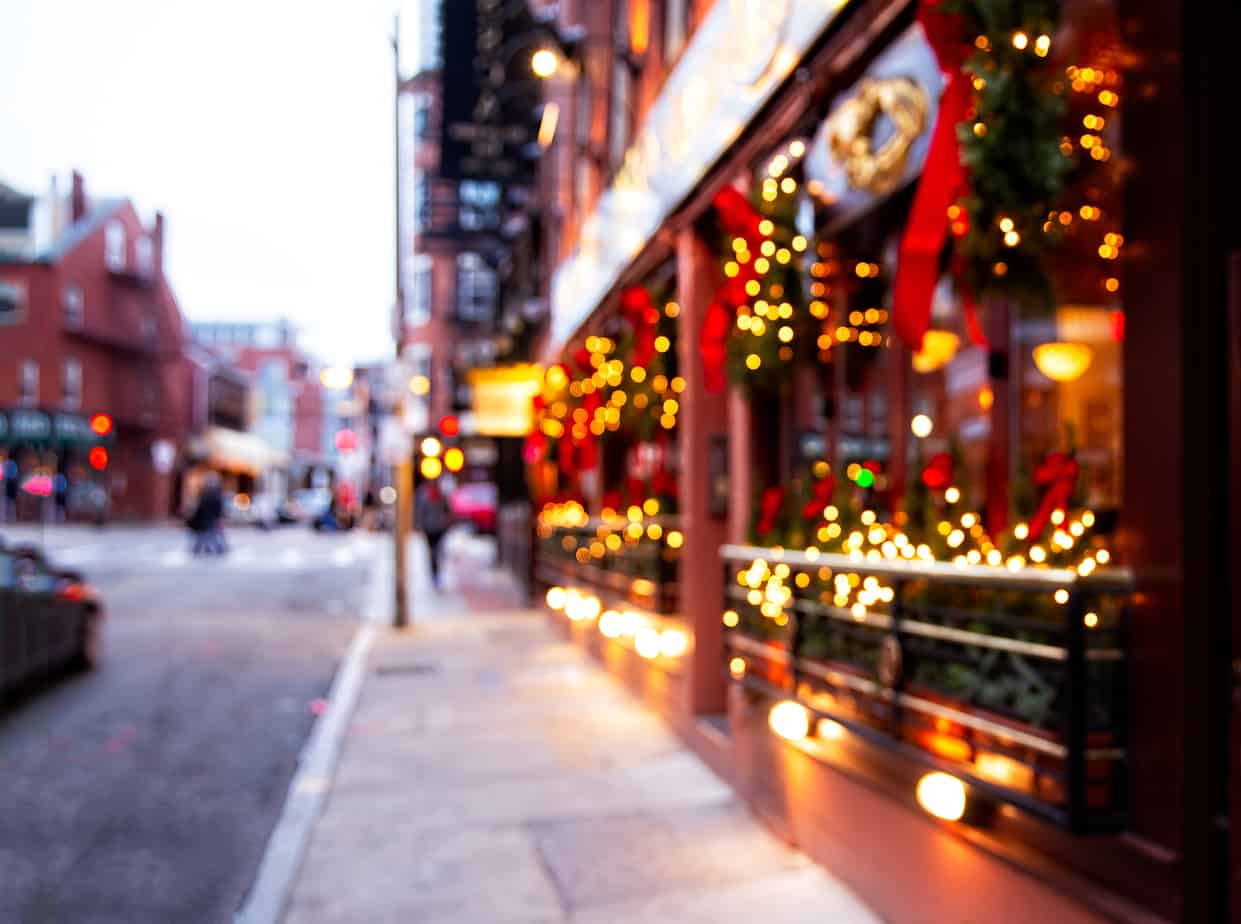 Christmas in New England - a city street with Christmas illuminations. blurred background. Christmas lights and Christmas decorations on the street