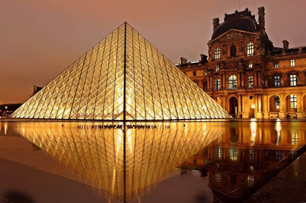 the louvre illuminated at night - 5 day paris itinerary post