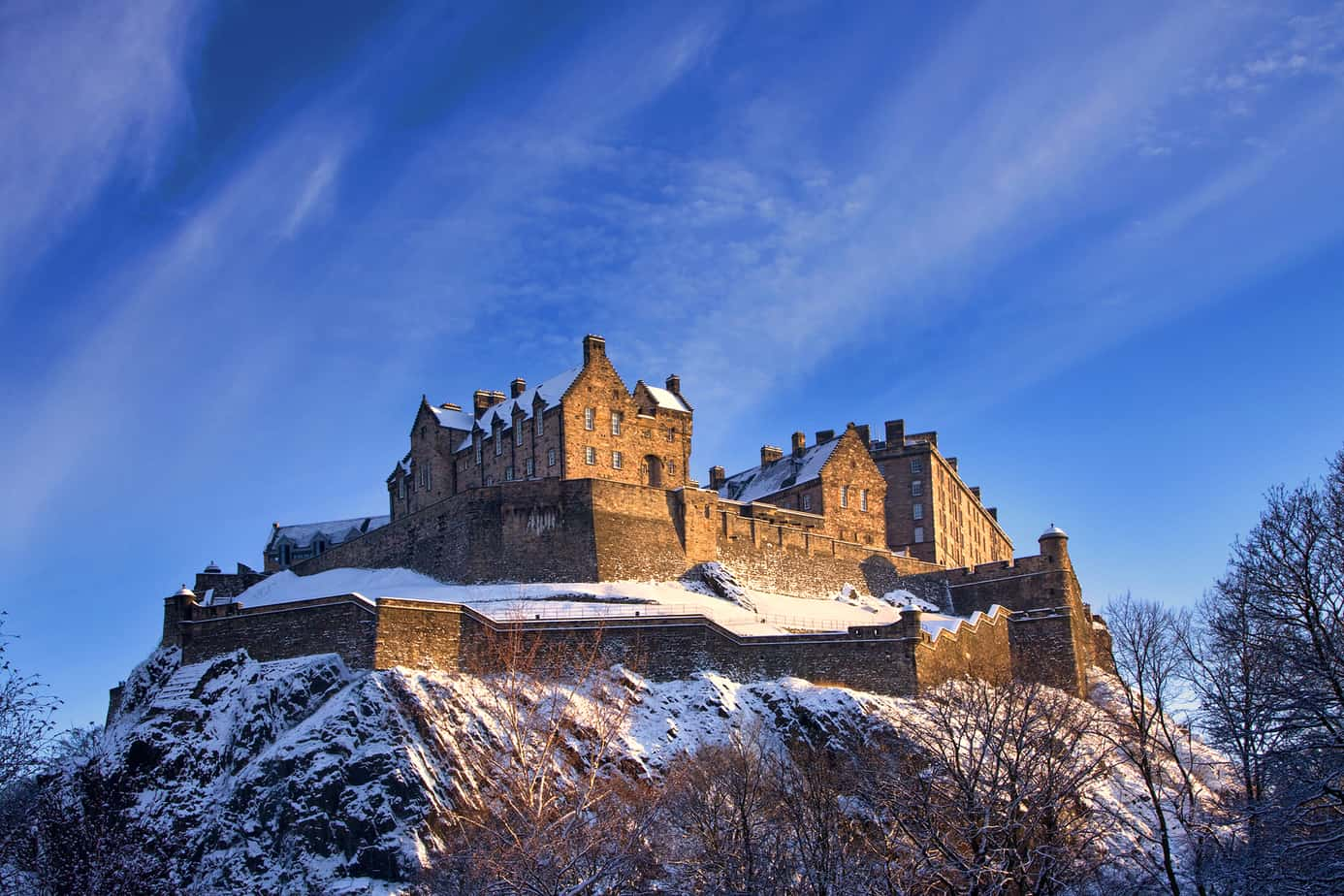 scotland is one of the best honeymoon destinations for adventurous couples - image of edinburgh castle surrounded by snow