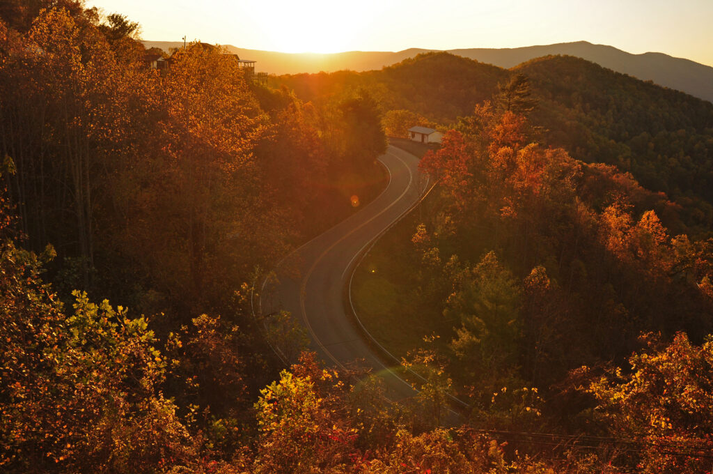 the blue ridge parkway winds near asheville north carolina at golden hour