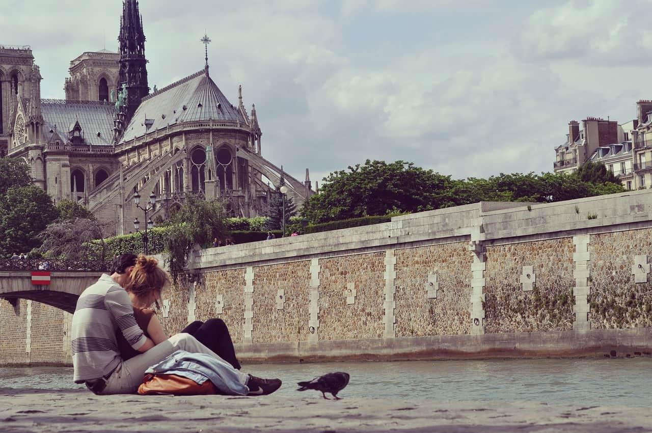 honeymoon europe trip - couple sitting in paris