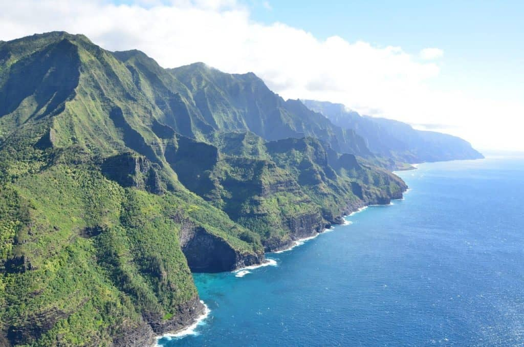 the coast of kauai hawaii green mountains and blue sea