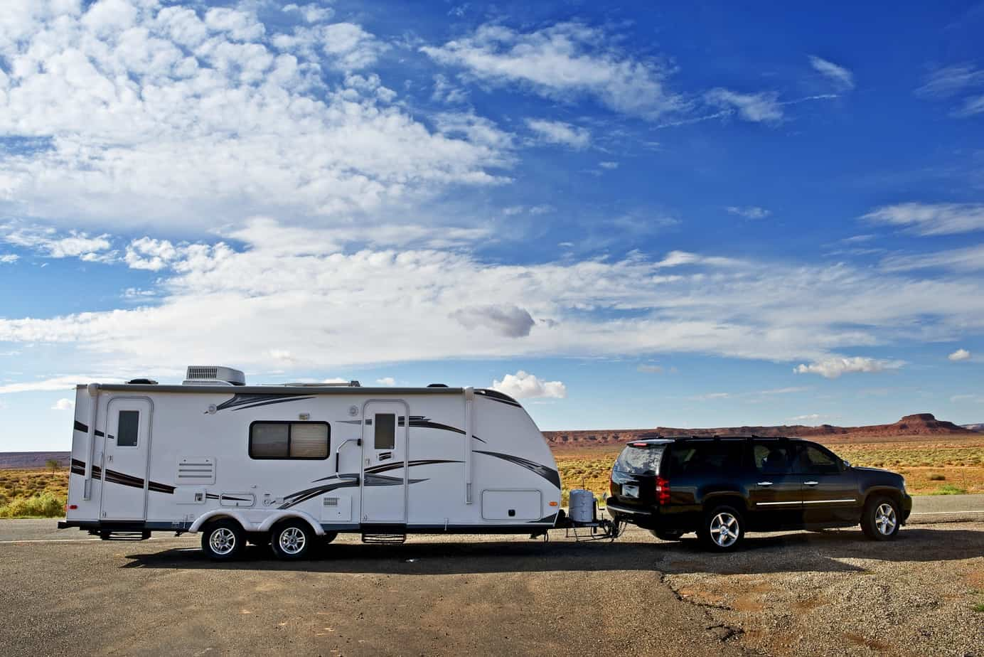 travel trailer being pulled by SUV in desert location - full time RV living
