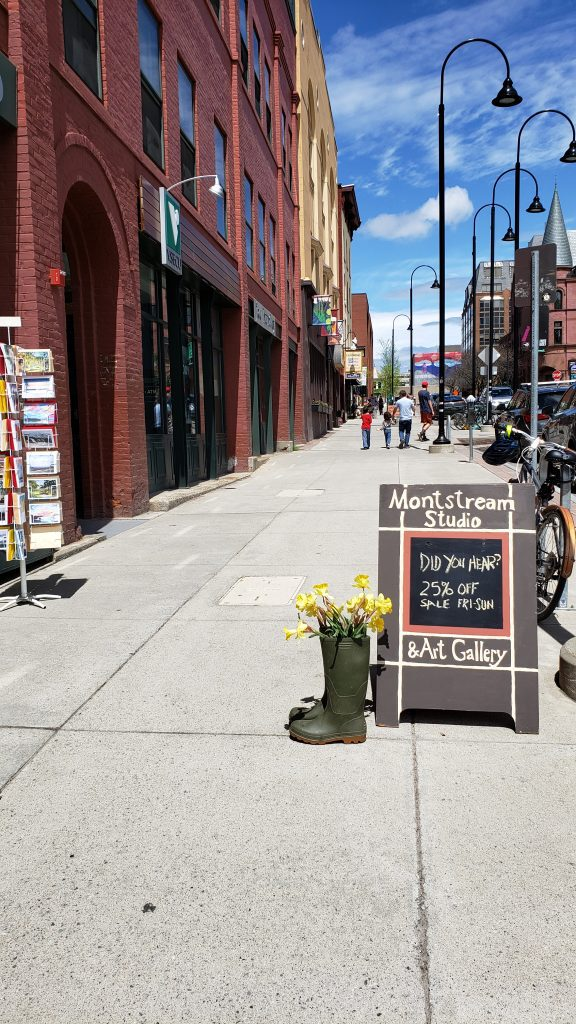 photo of empty city sidewalk and signs - stuff to do in burlington vt