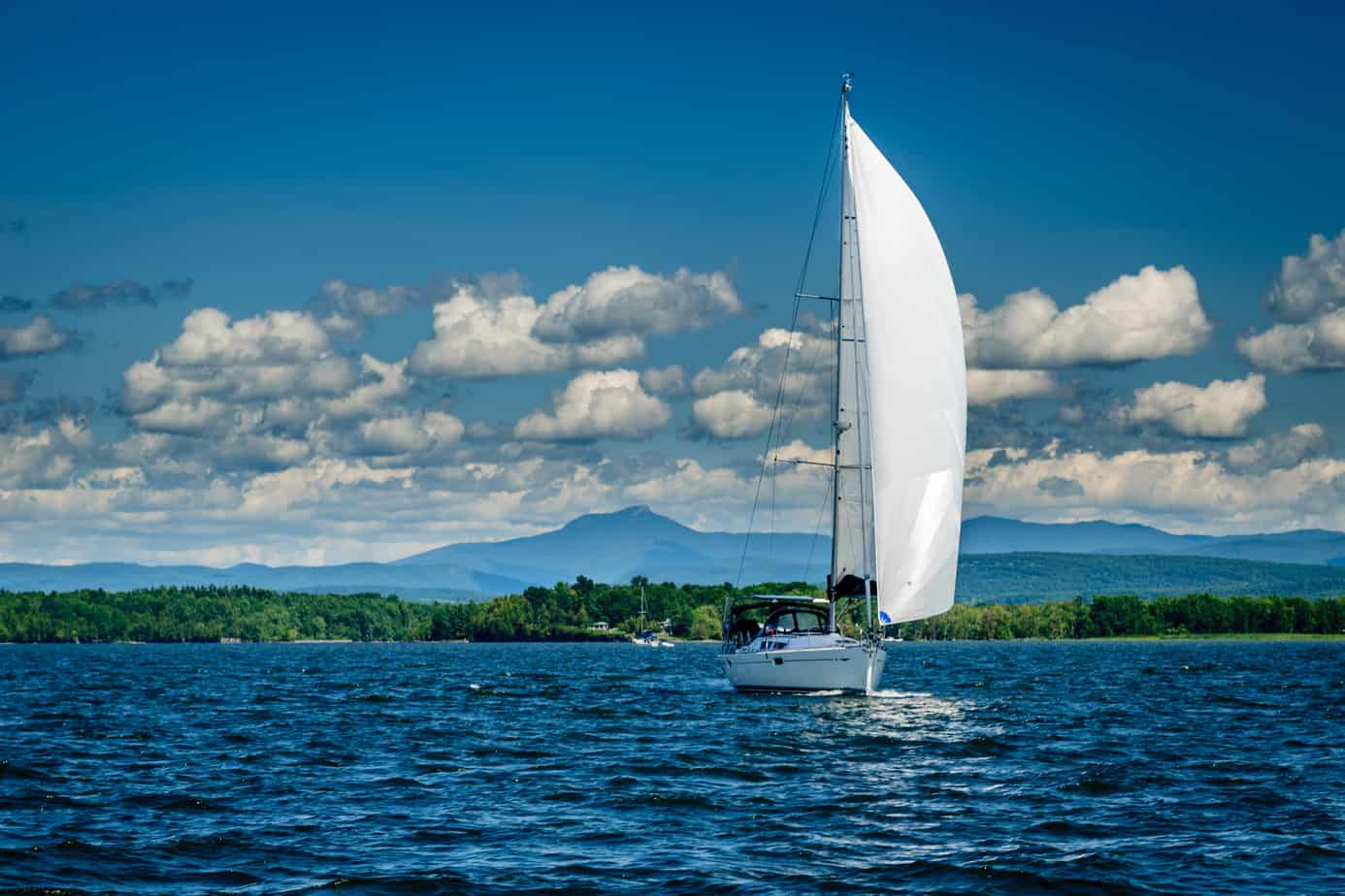 things to do in burlington vt - white sailboat on the blue waters of lake champlain