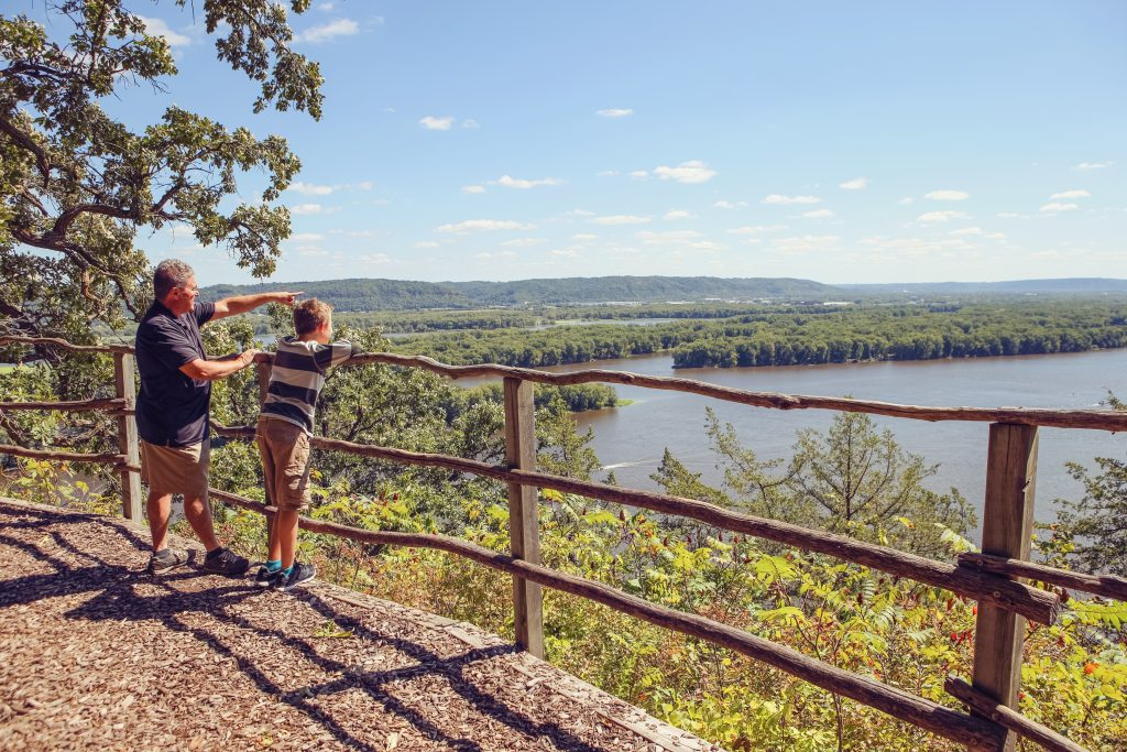 People standing at a scenic overlook on the Mississippi River