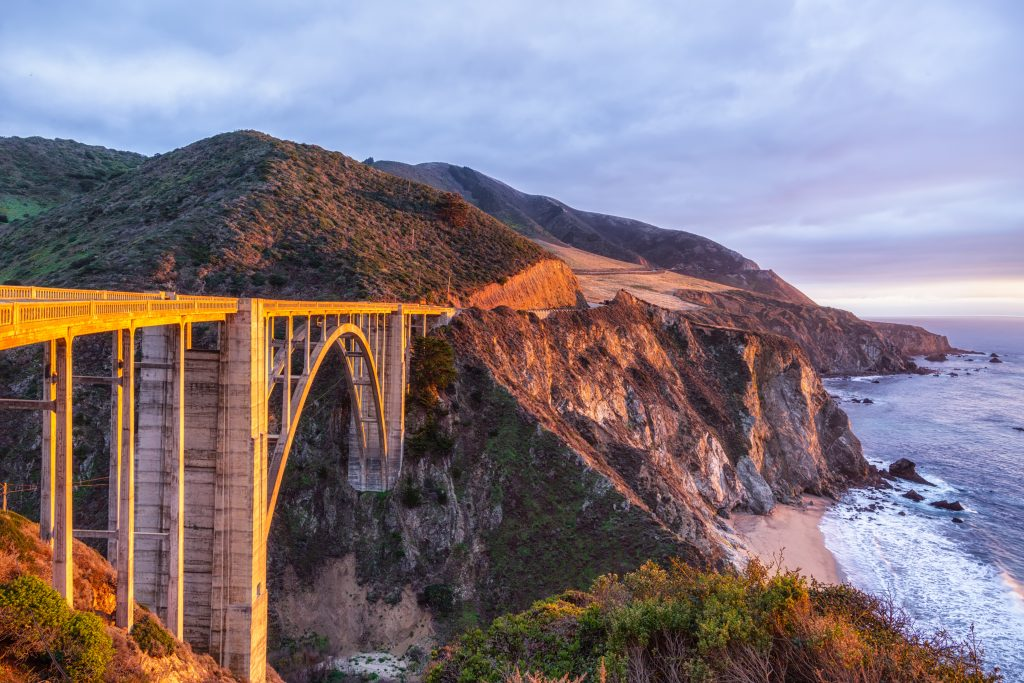 an impressive bridge over an ocean cliff, Pacific Highway in California