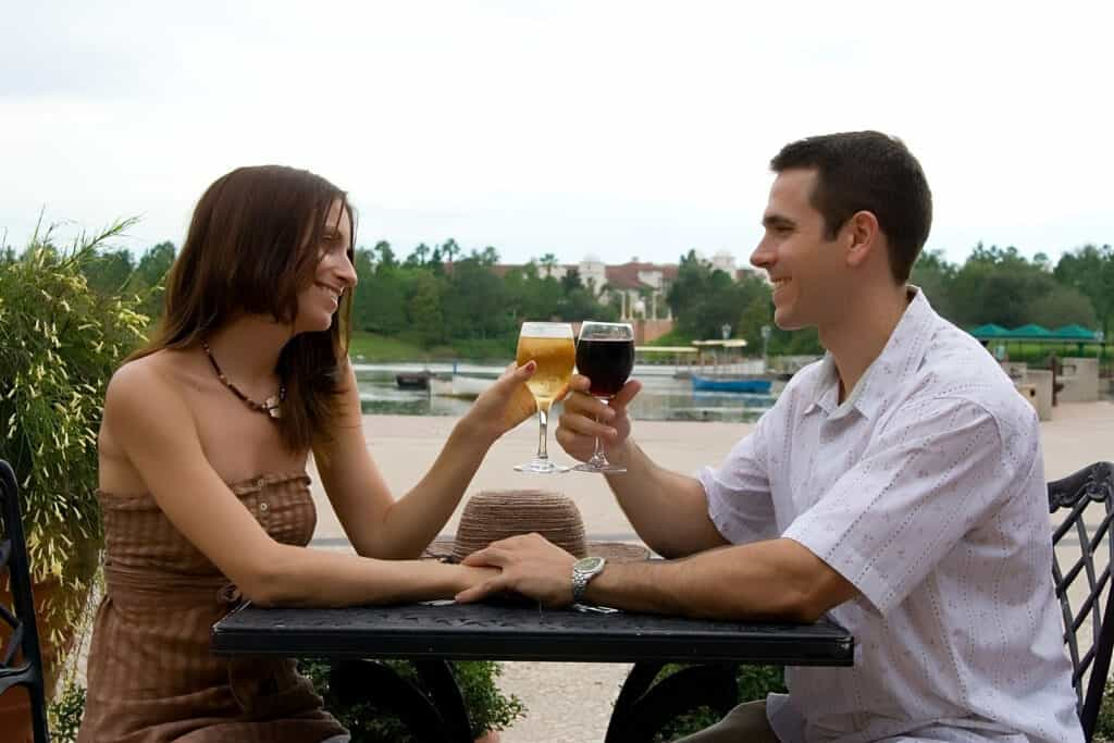vacation - couple sitting in a restaurant drinking wine