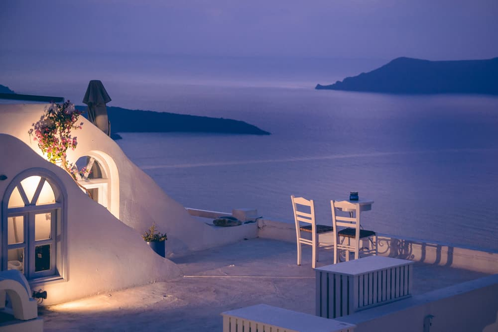 Romantic dinner with beautiful view on Santorini island, Greece