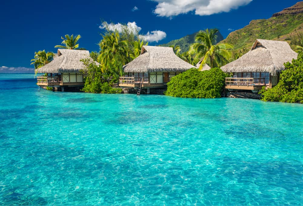 Overwater villas in tropical lagoon of Moorea Island