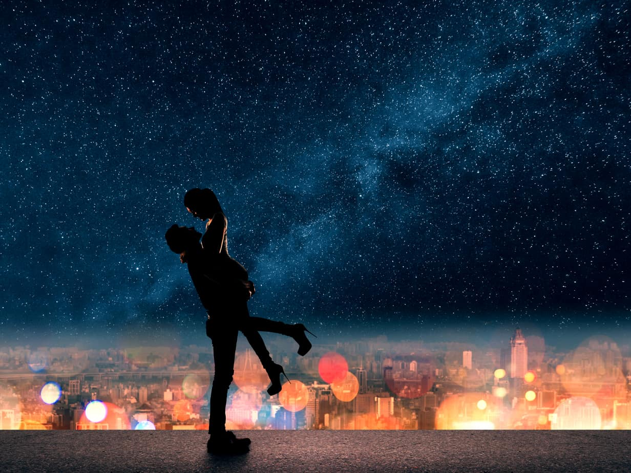 most romantic places in the world image - Silhouette of Asian couple, man hold his girlfriend up above the city in night under stars.