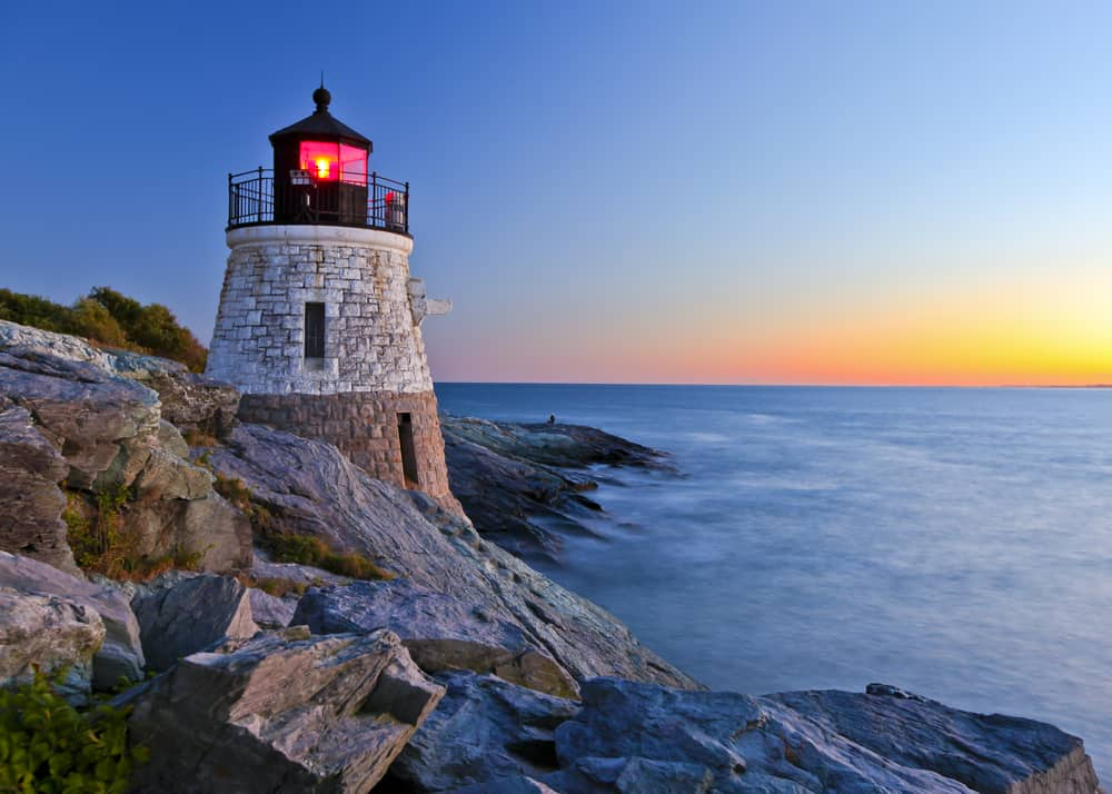 lighthouse at sunset on rocky coast - newport rhode island