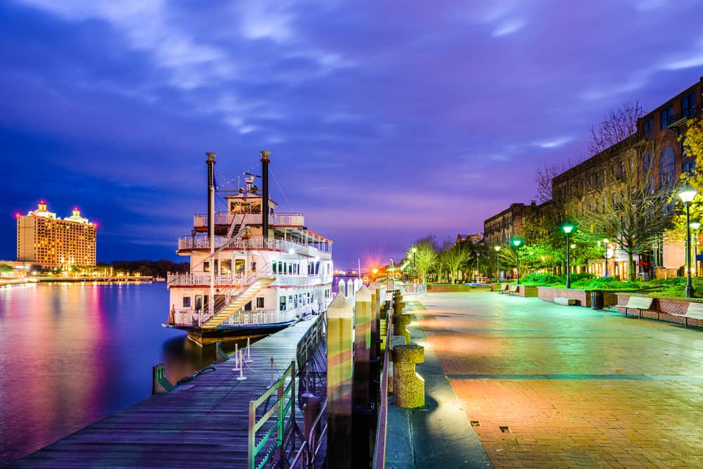 Savannah, Georgia, USA riverfront promenade at twilight.