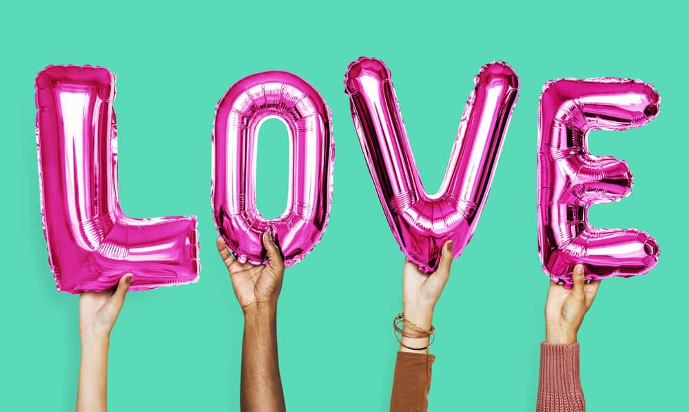 what is real love header image - Hands showing love balloons word