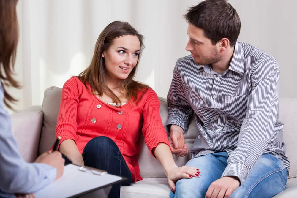 tips for couples counseling - image of couple sitting side by side on couch in a therapy setting