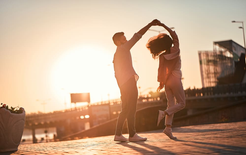 romantic things to do in omaha - couple dancing in an unknown city at dusk