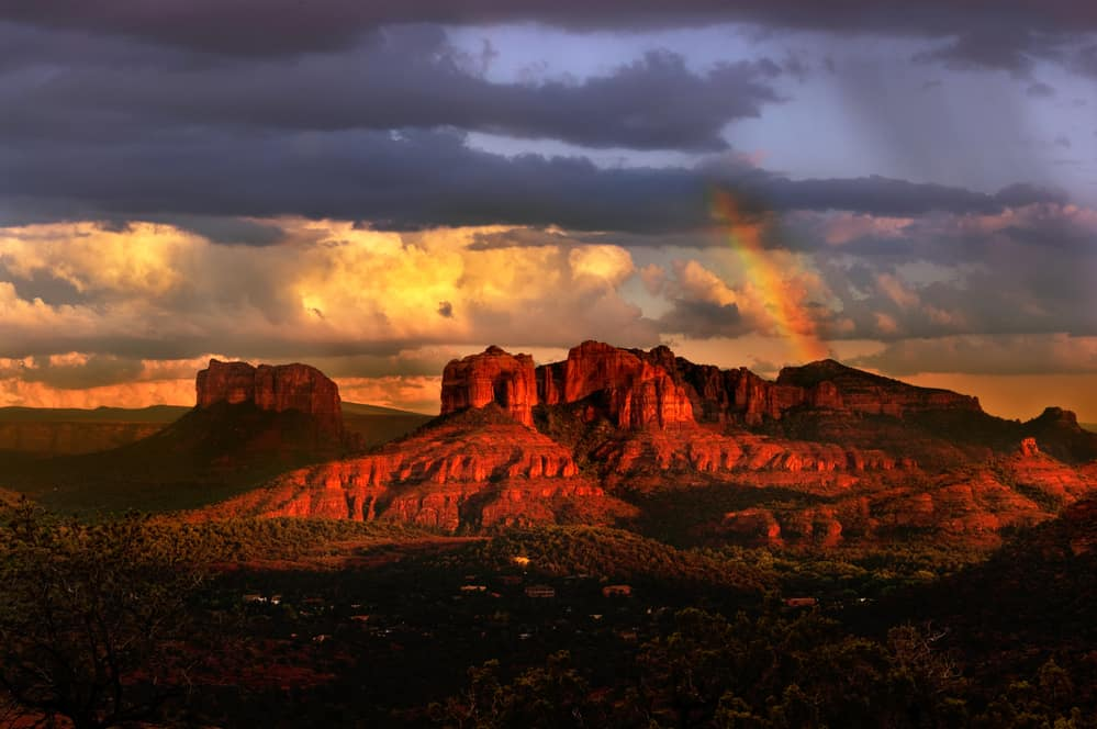 romantic things to do in sedona - Beautiful Sedona Arizona during sunset, rainbow and dramatic sky over red desert butte scene