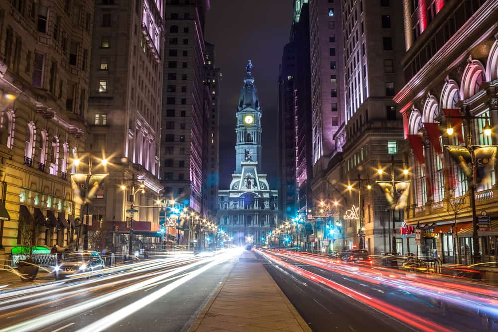 romantic things to do in philadelphia - image of busy downtown street at night, with car lights shown as glares, long-exposure shot