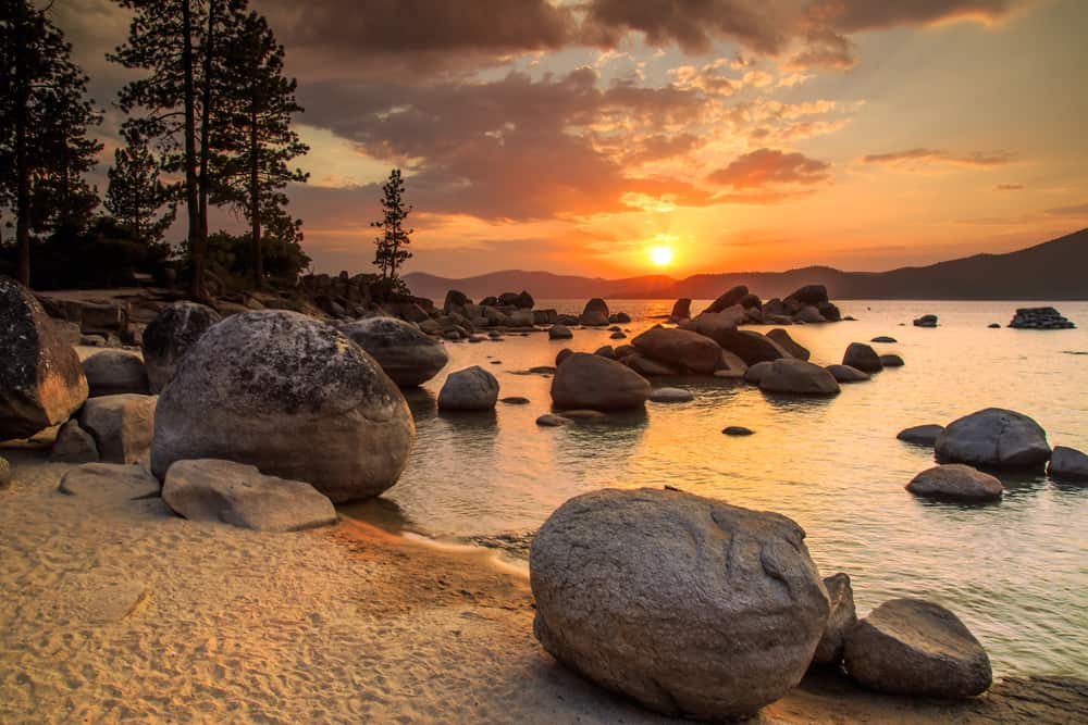 romantic things to do in lake tahoe - beautiful lake filled with rocks during a golden sunset